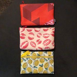 Trio of makeup bags.
